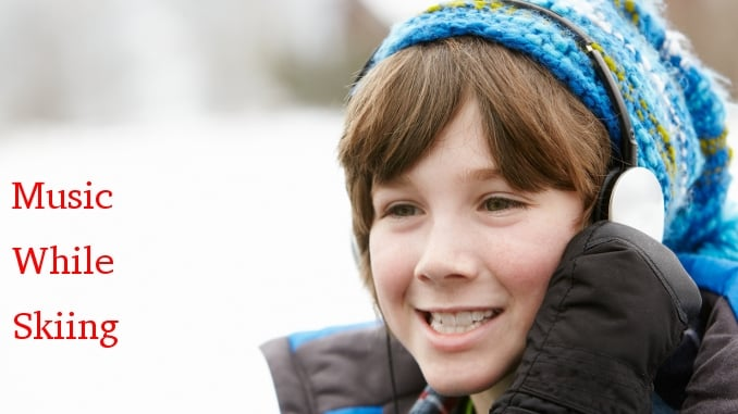 Music while skiing -- boy in winter wear with headphones
