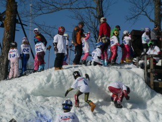 Line 'Em Up! Children Lining up to Ski Race