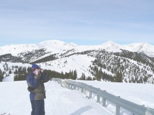 The Skiiing ABCs -- Brian snapping a photo of the Majestic Colorado Rockies on top of Monarch Mountan