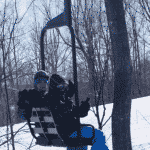 bad ski news -- two guys riding up a Ski Brule chairlift