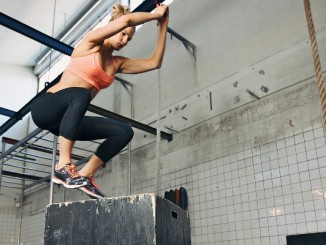 Losing the Weight -- Womand performing box jumps
