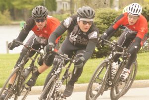 Diablo Criterium 2016 -- three cyclists cornering left.
