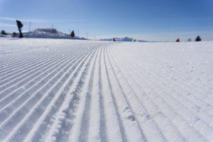 Groovy Hardpack not Powder Skiing -- a groomed ski run