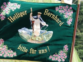 The patron saint of skiers Saint Bernard of Montjoux -- the Tyrolean Alpine Guard Flag