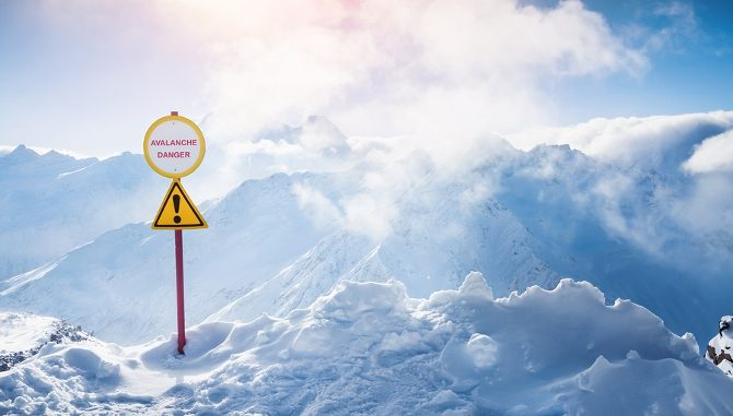 Avalanche! An avalanche warning sign on a mountain