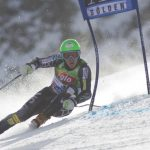 Skiing ABCs L -- Ted Ligety carving around a GS gate