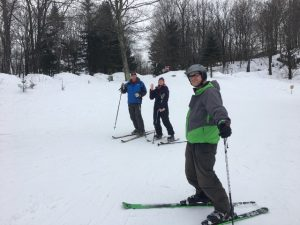 Frist ski trip -- three peoplep posing in their ski gear