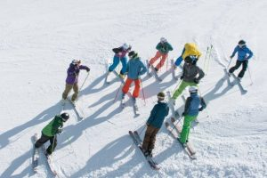 Go with a Pro -- Adults taking ski lessons