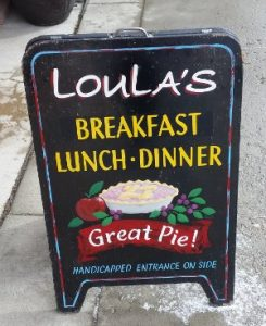 whitefish dining review -- a photo of Loula's Cafe sign