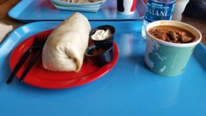 Whitefish Dining Review -- a burrito and bowl of chilli on a blue tray