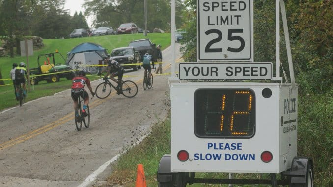 Grafton Pumpkin Cyclocross 2018 Race REport -- a hoto of cyclists and a radar speed check station