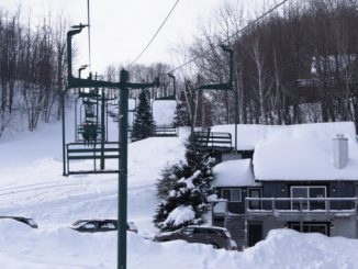 A picture from the main lift looking uphill at Whitecap Mountain Resort