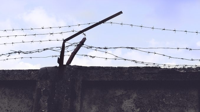 Epic, Ikon, Peak, etc The Debate on Multi-Resort Passes -- a prison wall with barbed wire
