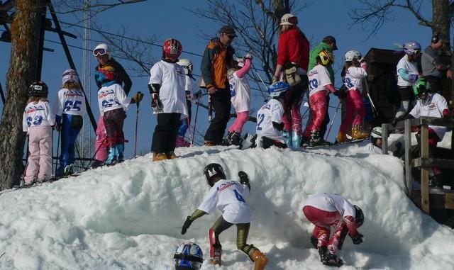 Line 'Em Up! Children Lining up to Ski Race