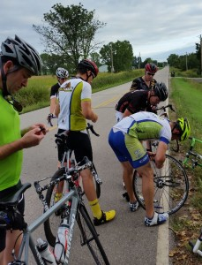Vail buys Wilmot Moutain -- Cyclists changing a flat tire
