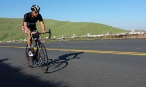 Rib Mountain Climb -- man riding a bicycle uphill