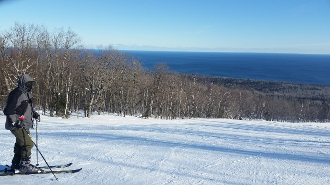 Stay warm skiing -- A skier overlooking Lake Superior at Lutsen Minnesota