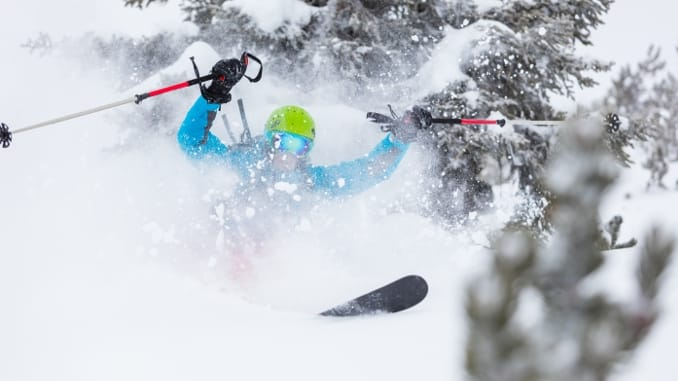 Powder Skiing how I pine for it -- Skier blowing up a stash of powder snow