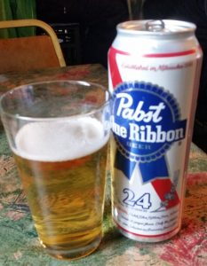 go with a pro - skiing is done -- a picture of 24 oz Pabst Blue Ribbon