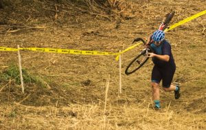 Sunnyview Cyclocross 2018 -- Adam running up the berm shouldering his bike